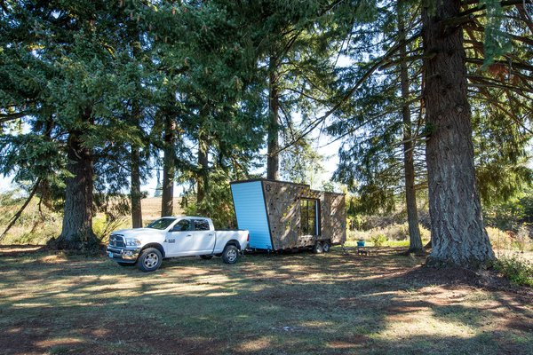 Th towable, double-axe trailer home is 28 feet long.