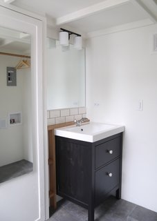The bathroom is located at the back of the house.