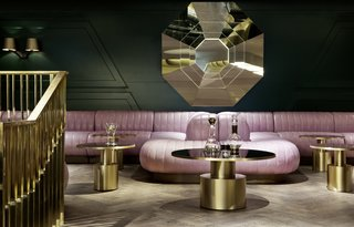 Inspired by Sea Containers House – a landmark building on the south bank of the River Thames in London – the bar is furnished with leather banquettes in cool lavender shades, velour lounge chairs, mirrored tables, and gold and brass accents.