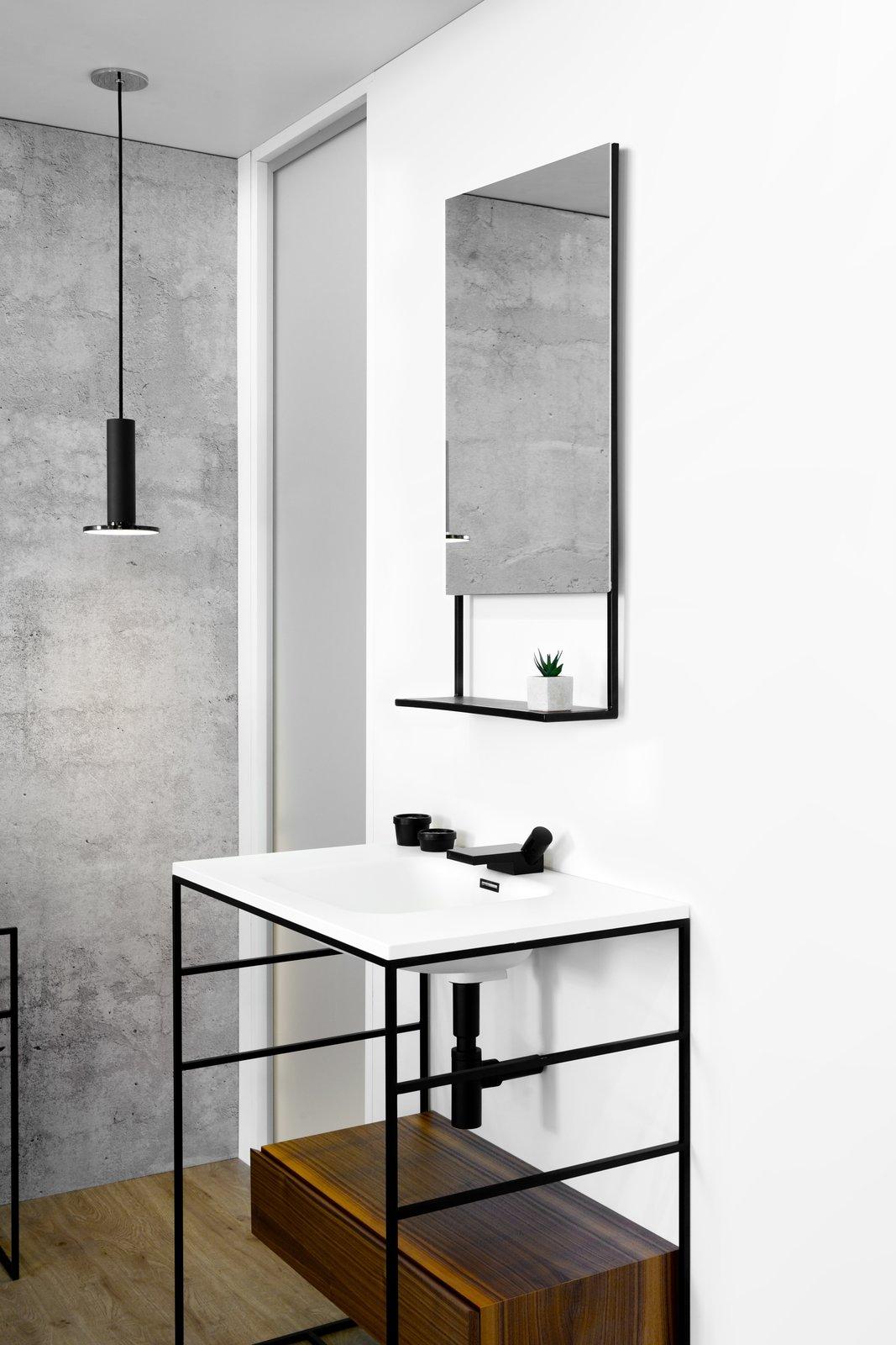 Bath Room Medium Hardwood Floor Wall Mount Sink And Pendant Lighting This