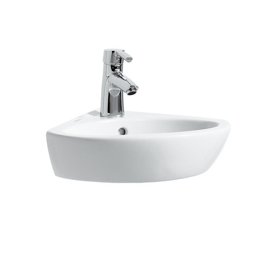 Put bathroom corners to good use with a wall mounted or pedestal corner sink or vanity.  Photo 5 of 9 in 7 Stylish Bathroom Sinks That Can Fit in Even the Tiniest of Spaces