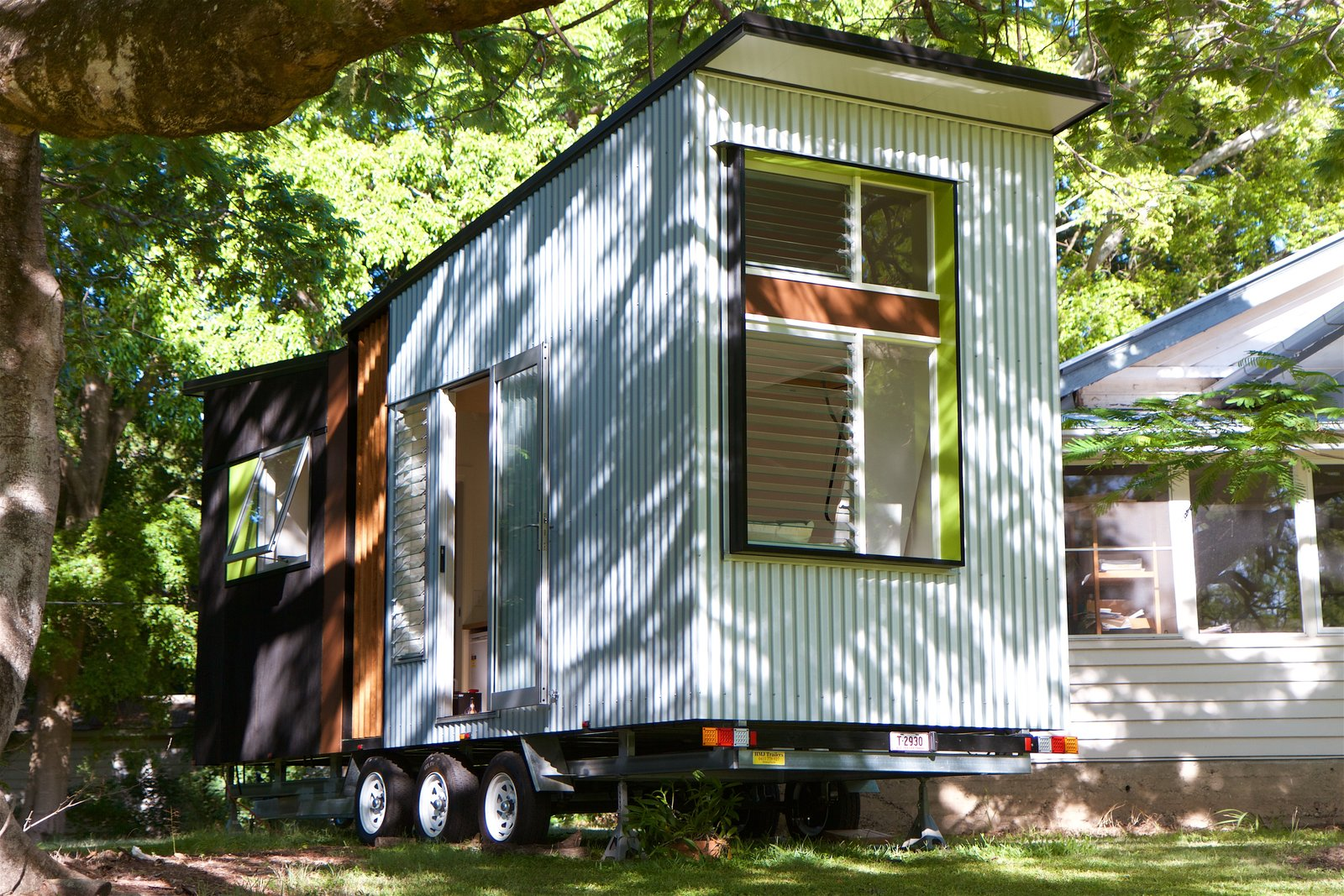 Exterior, Camper Building Type, Tiny Home Building Type, Metal Siding Material, and Butterfly RoofLine The house can accommodation a range of optional extras such as shelving, storage, window or door additions, awnings, planter boxes, and more.  Best Photos from This Midcentury-Inspired Tiny House Radiates Clever Design