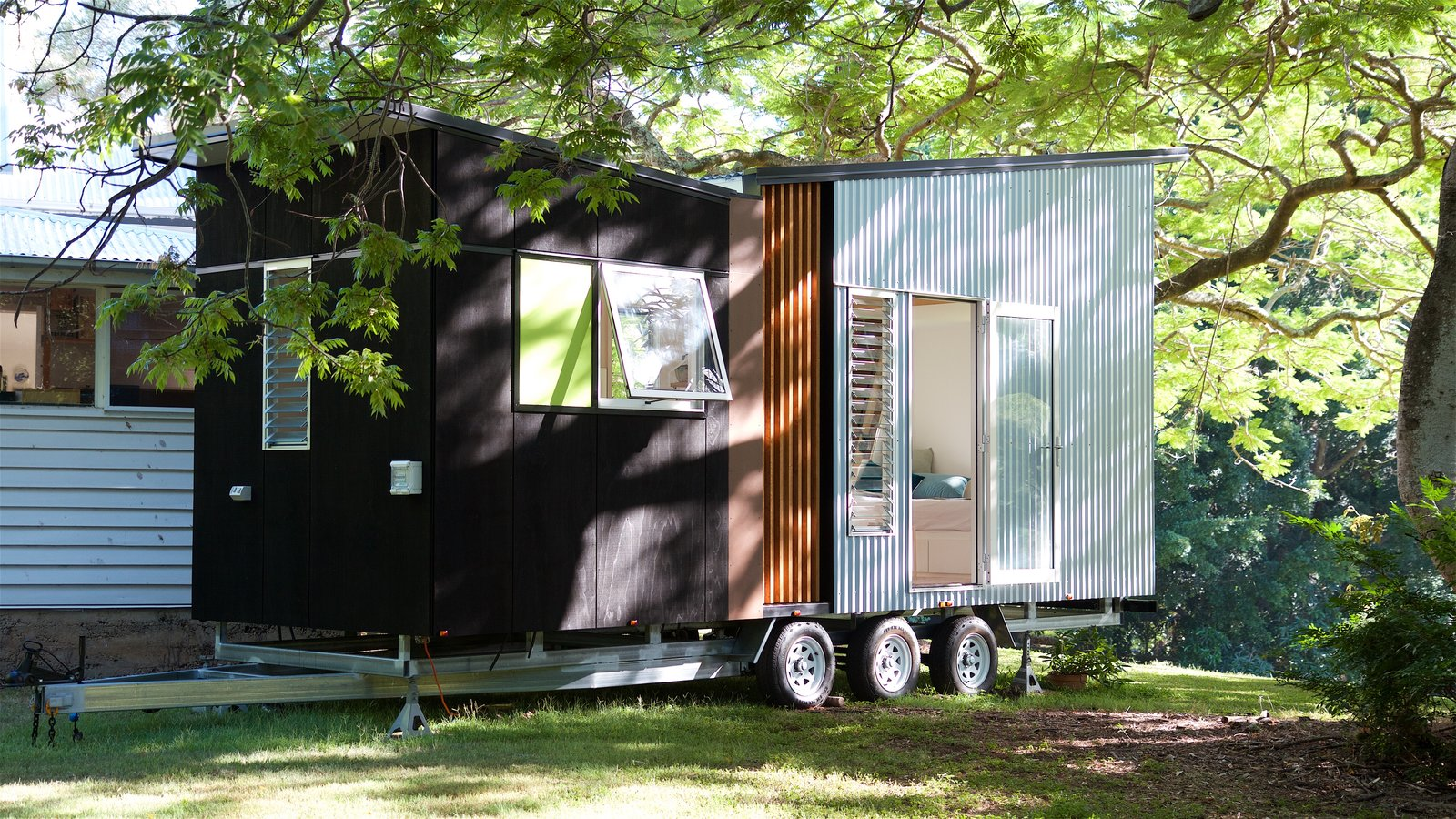 Exterior, Butterfly, Metal, Tiny Home, Camper, Wood, Cabin, and Metal With a base price of $79,000, this 194-square-foot trailer is a complete tiny house on wheels and offers its owners flexibility of layout, as well as a wide range of optional customizations.  Best Exterior Camper Tiny Home Butterfly Photos from This Midcentury-Inspired Tiny House Radiates Clever Design