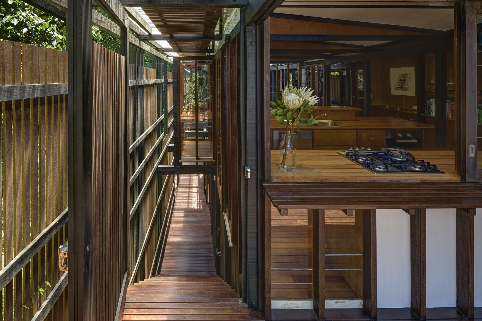 A hallway that runs the length of each pavilion helps improve circulation, and provides storage areas.