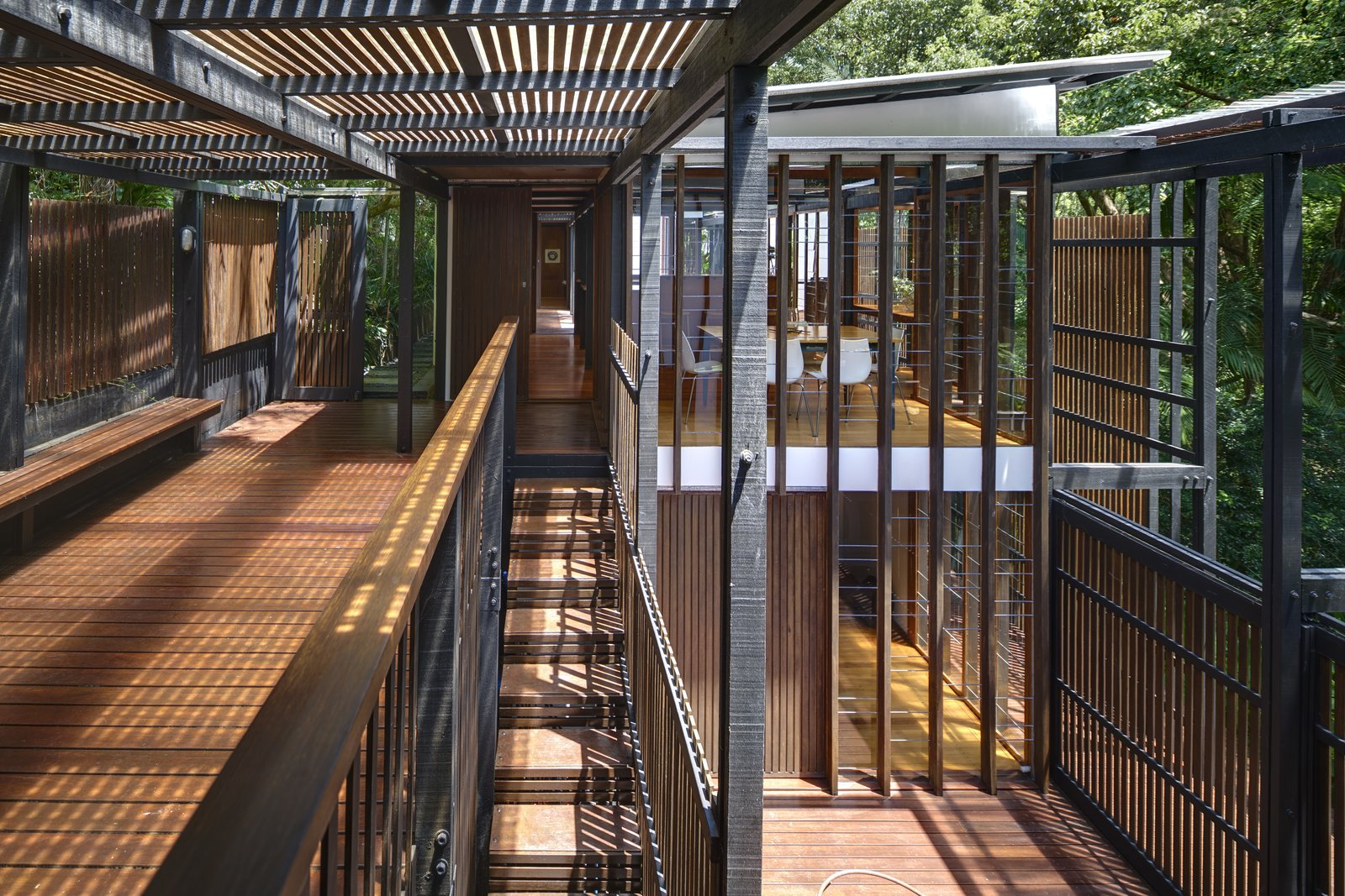 Outdoor, Large Patio, Porch, Deck, Wood Patio, Porch, Deck, and Trees Comprised of linked pavilions, the home feels porous and well-connected with nature.  Best Photos from This Brisbane Home For Sale Is a Lush Sanctuary