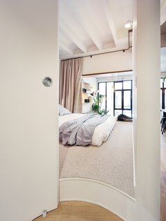 "They oriented both the bedrooms towards the ""window wall"" to allow better light penetration to these spaces."