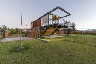 To enable the two families to live independently, and interdependently, Estudio A0 co-founder Ana María Durán Calisto came up with a 5,457-square-foot home that consists of two volumes, set in a Z formation.