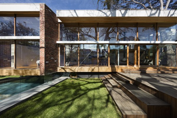 The original residence had its living areas located on the rendered precast first floor, which sits atop a base of external clinker brick planes.