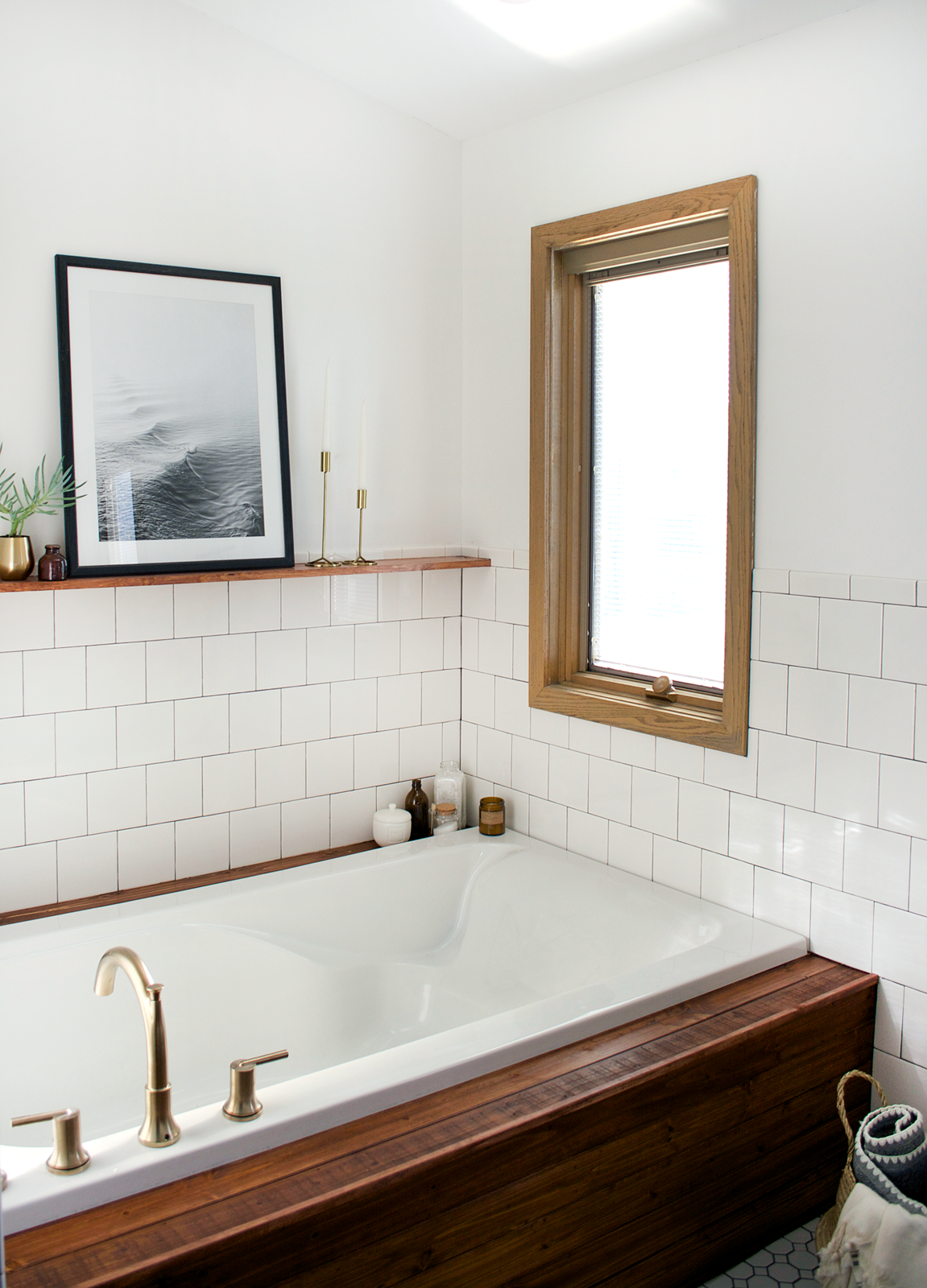 Bath, Subway Tile, Drop In, and Ceramic Tile For a while, Goldman could not decide between free standing bathtub and a built-it, but was sold on a built-in when she saw inspiration photos of wood panelled tubs.  Best Bath Drop In Ceramic Tile Photos from Before & After: An Outdated Bathroom Gets a Complete Makeover in Just 6 Weeks