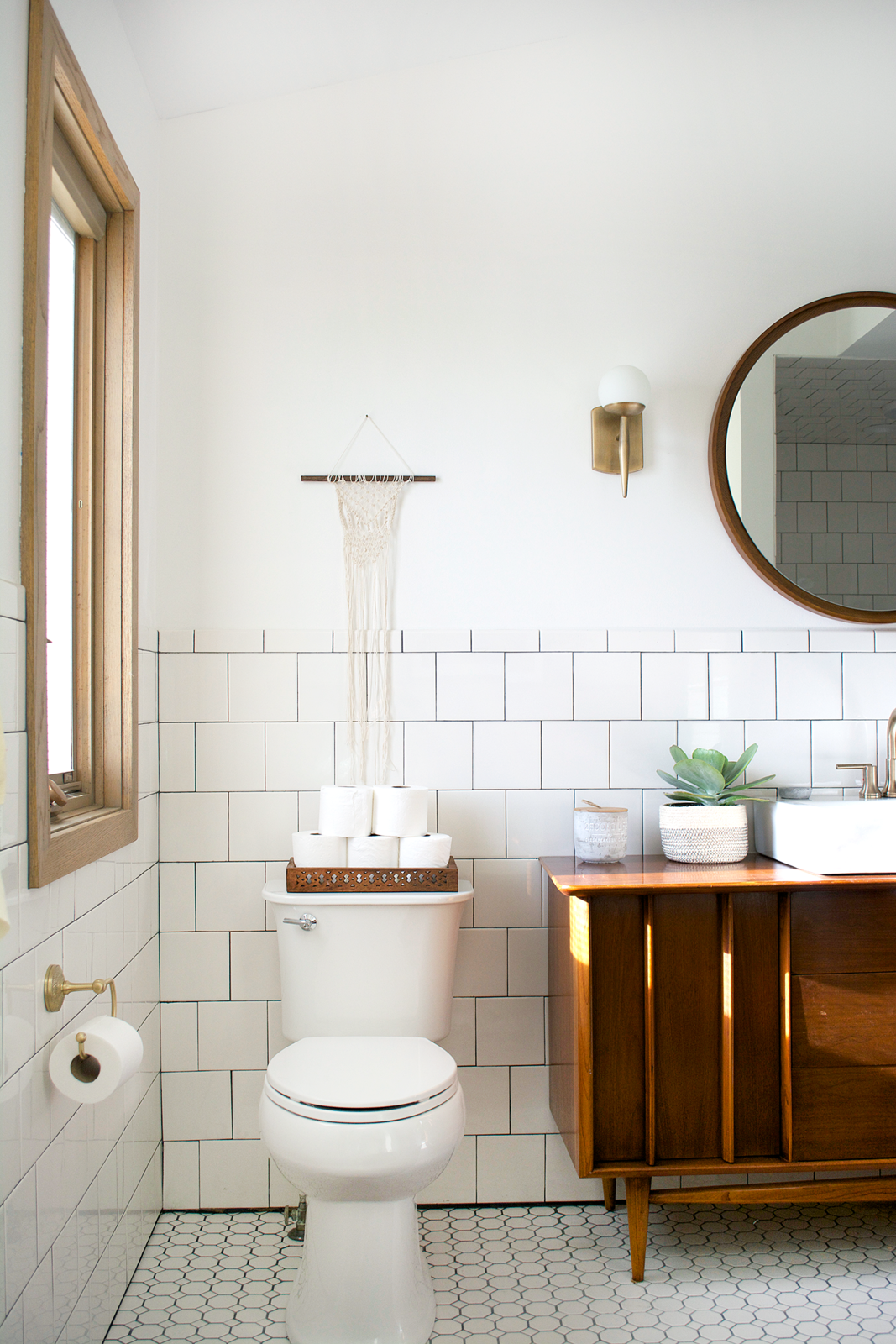 Bath, Wood, Vessel, Two Piece, Subway Tile, Ceramic Tile, and Wall The toilet was fairly new, so they left it as it.  Bath Ceramic Tile Subway Tile Two Piece Photos from Before & After: An Outdated Bathroom Gets a Complete Makeover in Just 6 Weeks