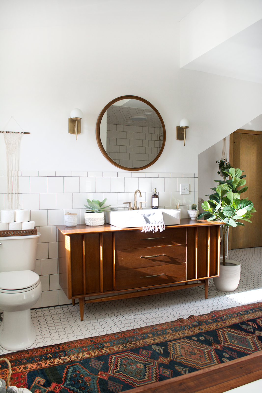 Bath, Vessel, Wood, Ceramic Tile, Two Piece, Subway Tile, and Wall She had a vessel sink and a Delta faucet in champagne bronze incorporated into the vintage dresser.  Bath Ceramic Tile Subway Tile Two Piece Photos from Before & After: An Outdated Bathroom Gets a Complete Makeover in Just 6 Weeks