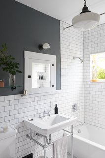 White subway tiles and dark grout give the new bathroom a crisp, clean look.