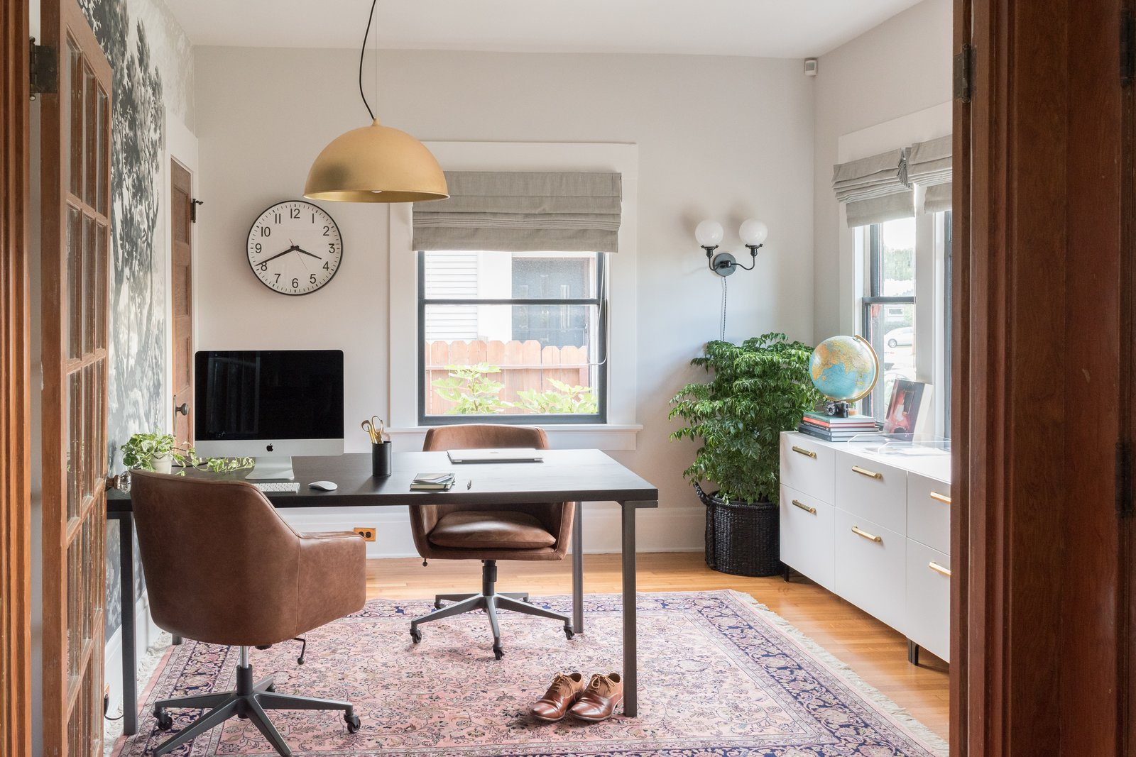 Office, Storage, Study, Library, Lamps, Desk, Craft Room, Chair, and Medium Hardwood The home office was renovated in seven weeks as part of the 2017 One Room Challenge, and was selected as one of two winners.  Office Medium Hardwood Library Photos from Before & After: A DIY Couple Tackle Their 1915 Craftsman in San Diego