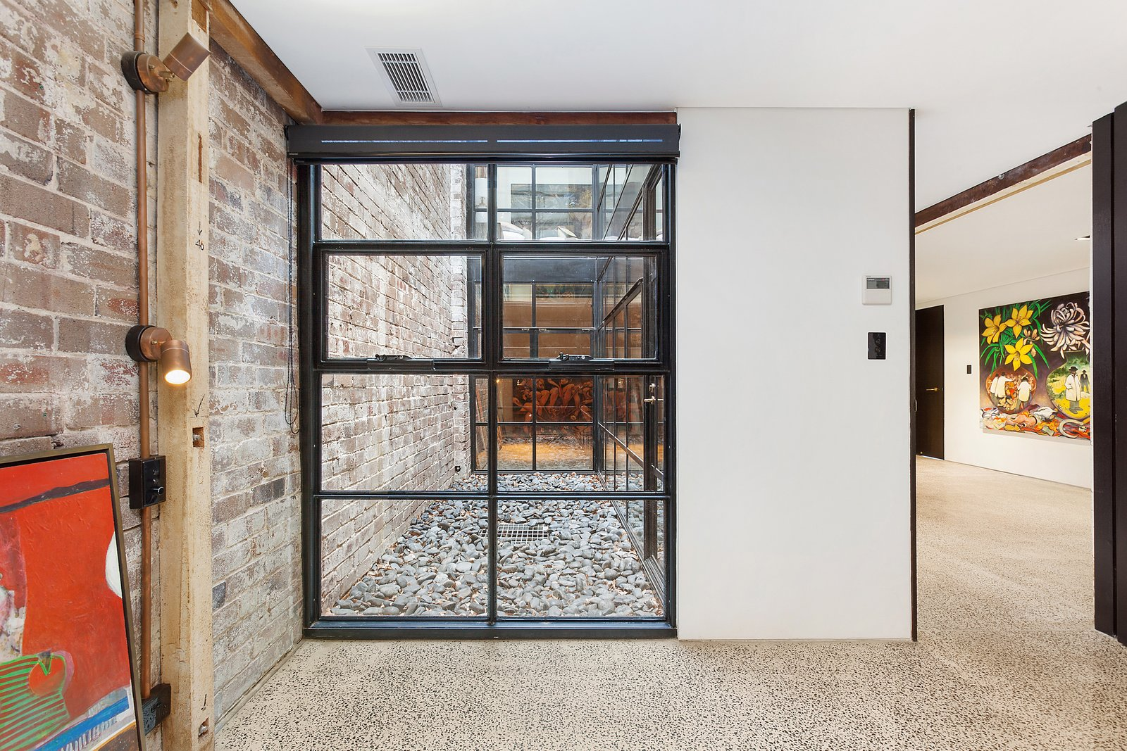 Windows and Metal Crittall-style windows bring in plenty of light.  Photo 11 of 12 in The Glowing Converted Warehouse of Painter Fred Cress Is Open For Bids