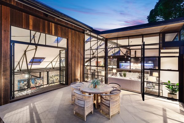 The open plan upper level includes a private rooftop terrace