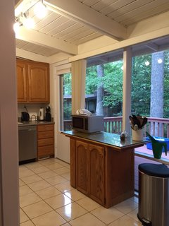 The small island in the original kitchen does not encourage frequent use.
