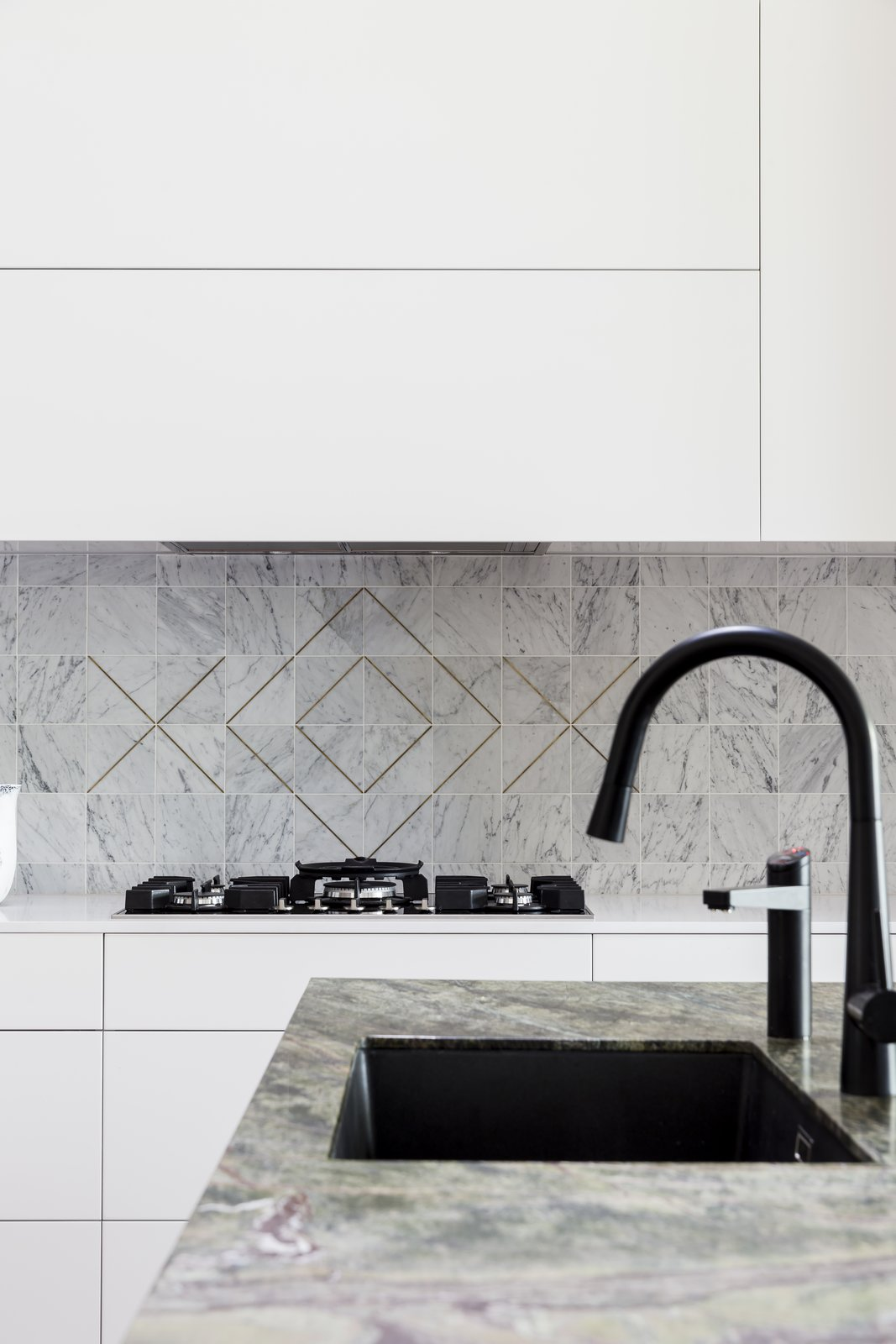 Kitchen, Cooktops, Undermount Sink, and White Cabinet This kitchen is currently nominated in the finals for The Kitchen & Bathroom Designers Institute of Australia's 2018 small kitchen of the year award.    Photo 3 of 11 in 10 Design Tips for Kitchens, According to Expert Renovators