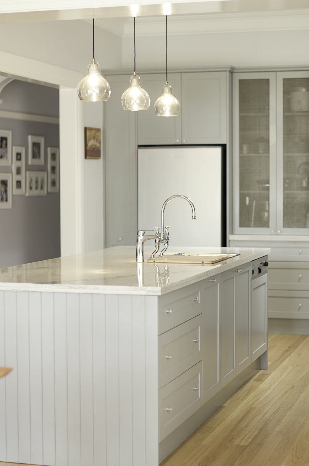 "Kitchen, Refrigerator, White Cabinet, Drop In Sink, Pendant Lighting, and Light Hardwood Floor This ""Kensington kitchen"" was designed by Nadia Hursky for Blue Tea Kitchens.    Photo 11 of 11 in 10 Design Tips For Kitchens, According to Expert Renovators"