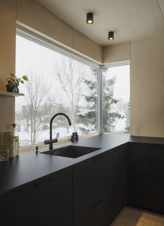 The kitchen looks out to woodland views.