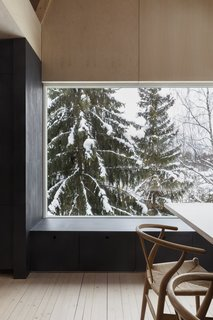 A large window affords views of the environment.