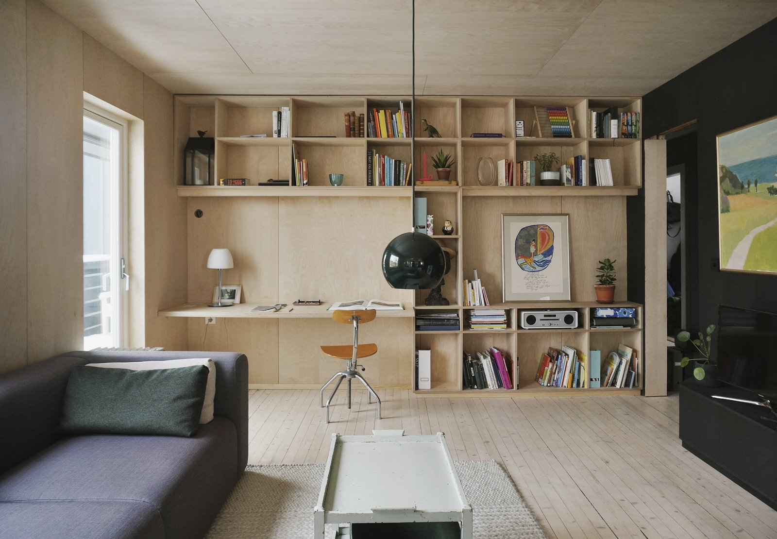 Office, Chair, Study, Shelves, Bookcase, Desk, Lamps, Light Hardwood, and Rug The living area and a study corner.  Best Office Rug Lamps Photos from A Renovated Apartment in Norway With a Dreamy Loft