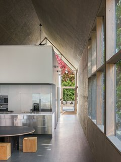 Corrugated metal siding was used for the exterior of the house, and natural wood and plywood were used throughout the interiors.