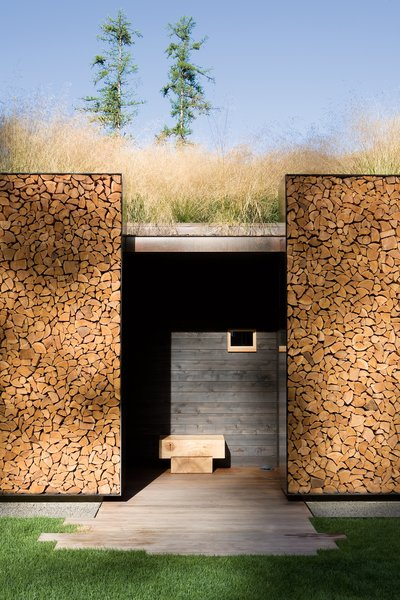 Designed by Austin, Texas–based studio Andersson-Wise Architects, the 12,500-square-foot Stone Creek Camp is sited on a sloping hill whose topography guides visitors to discover the grounds slowly: from the gatehouse to the master house, main lodge, and guesthouse. The eco-friendly family retreat features a stacked wood facade that was built from fallen trees found on the site; a sod green roof that provides insulation; and regionally sourced construction materials—including stone, wood, windows, and doors.