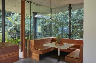 In the kitchen, a built-in timber breakfast booth is the perfect spot to enjoy the dappled morning sunlight.