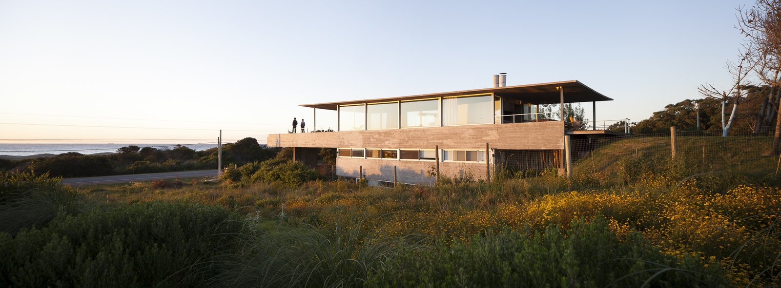 Exterior, Concrete Siding Material, Beach House Building Type, Flat RoofLine, and House Building Type Three bedrooms and bathrooms are located on the first level. Each room can adapt to accommodate a varying number of occupants.  Photo 2 of 12 in A Concrete Abode in Uruguay Embraces its Beachfront Setting