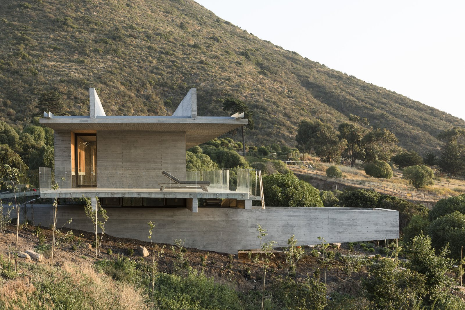 Exterior, Flat RoofLine, House Building Type, and Concrete Siding Material A cross sectional view of the house.  Photo 13 of 14 in This Chilean Concrete Home Levitates Off a Coastal Slope