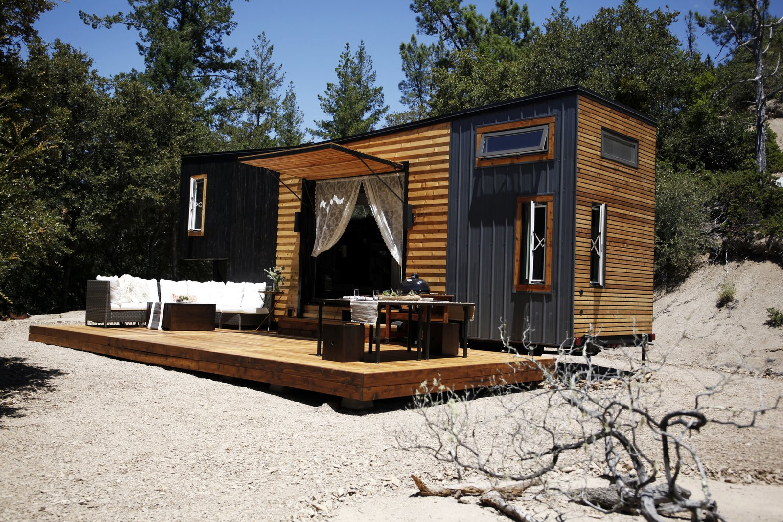 Exterior, Metal, Small Home, Wood, Tiny Home, Flat, and Metal Fishbeyn and Wright love that their home is set in a natural landscape with an incredible mountain view.      Best Exterior Metal Wood Flat Tiny Home Metal Photos from A California Couple Customize Their Tiny Home With Multi-Layered Interiors