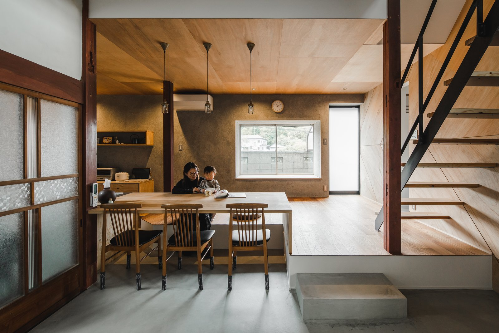 Dining, Concrete, Pendant, Medium Hardwood, Table, and Chair This 7,072-square-feet, two-story house consists of 80 tsubos, which were re-organized to accommodate modern living.   Best Dining Medium Hardwood Concrete Photos from Before & After: An Old Japanese Farmhouse Gets a Modern Facelift