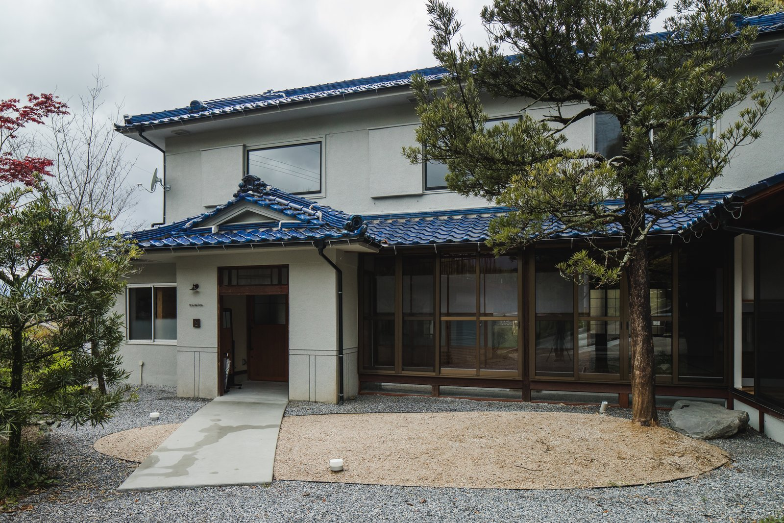 Exterior, Tile Roof Material, House Building Type, and Farmhouse Building Type The facade of the house in Ritto maintains traditional elements.  Photo 1 of 16 in Before & After: An Old Japanese Farmhouse Gets a Modern Facelift