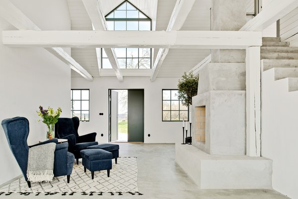 Poured concrete floors and crisp, white plastered walls have been used to give the interiors a bright and fresh look.