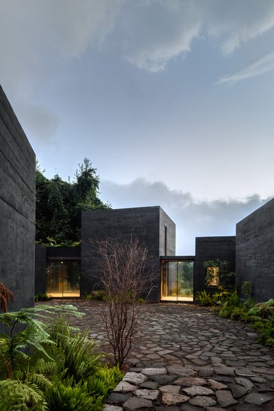 The walkways provide access to both the patio and the landscape beyond the property, offering views along the way.