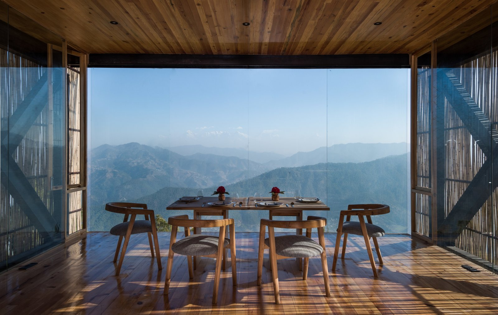 Dining Room, Chair, Medium Hardwood Floor, Table, and Recessed Lighting The upper volume of the main building holds the dining facilities.  Photo 5 of 15 in A New Retreat in the Indian Himalayas Captures Epic Views
