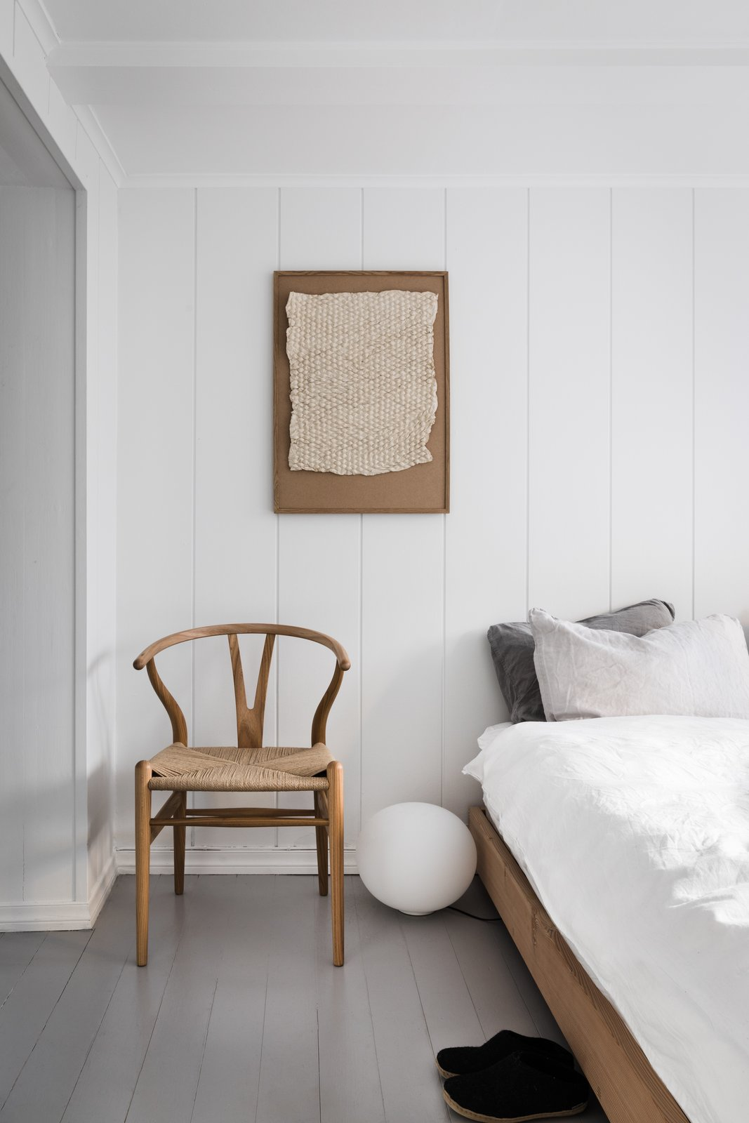 Bedroom, Bed, Floor Lighting, Chair, and Painted Wood Floor The remodeled townhouse, which was completed in 2016, has 750-square-foot of living space, including two bedrooms, and a bathroom, spread across three floors.  Photo 11 of 12 in An 18th-Century Townhouse Is Now a Chic Norwegian Rental