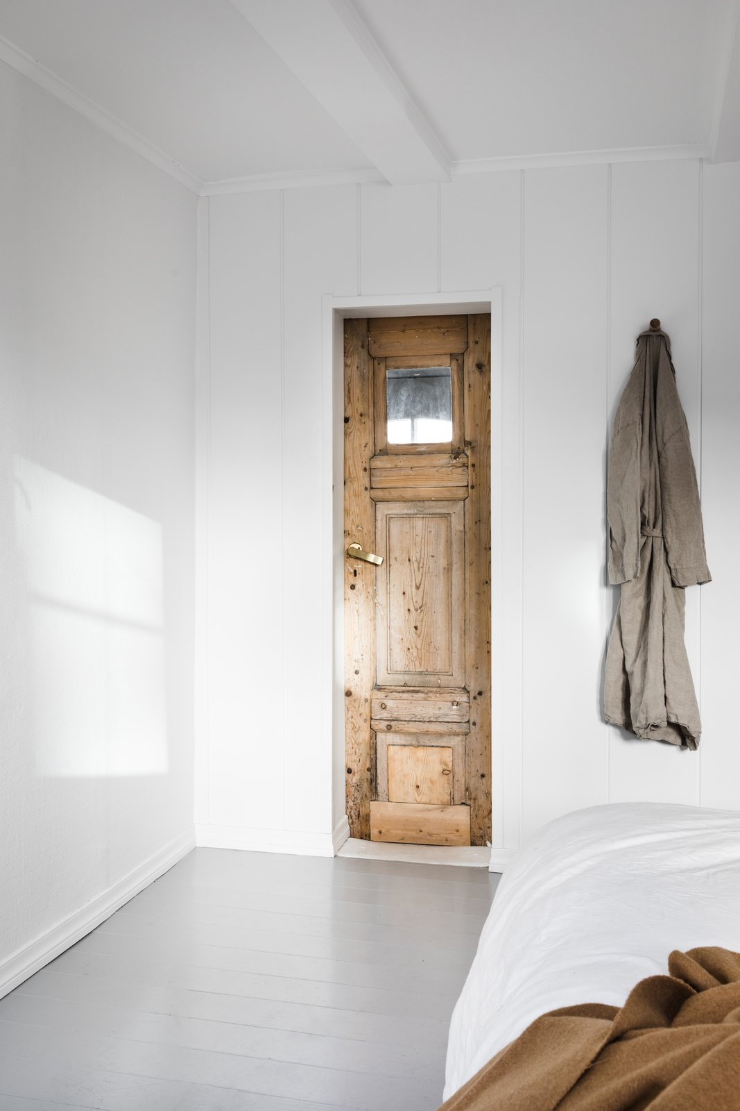 Bedroom, Bed, and Painted Wood Floor To maximize the limited floor area, Saunders ripped down all the non-structural walls to open up the interiors, so the spaces feel roomier.  Photo 10 of 12 in An 18th-Century Townhouse Is Now a Chic Norwegian Rental