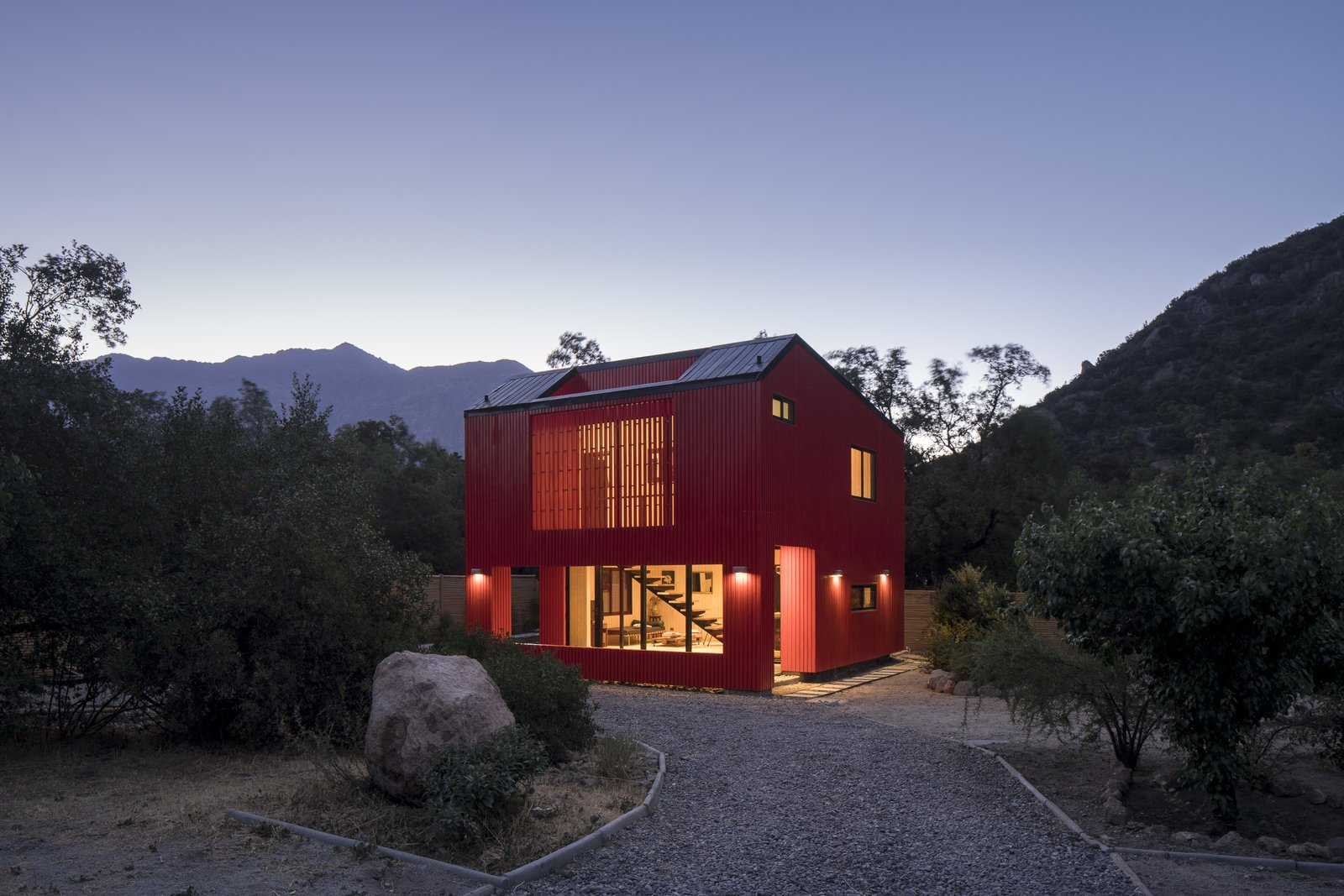 Exterior, Prefab, Small Home, House, Saltbox, Metal, and Metal The houses in this area are very isolated, with no visual contact between houses.  Exterior Saltbox Metal Small Home Photos from This Modular Home in Chile Has Us Seeing Red—in a Good Way