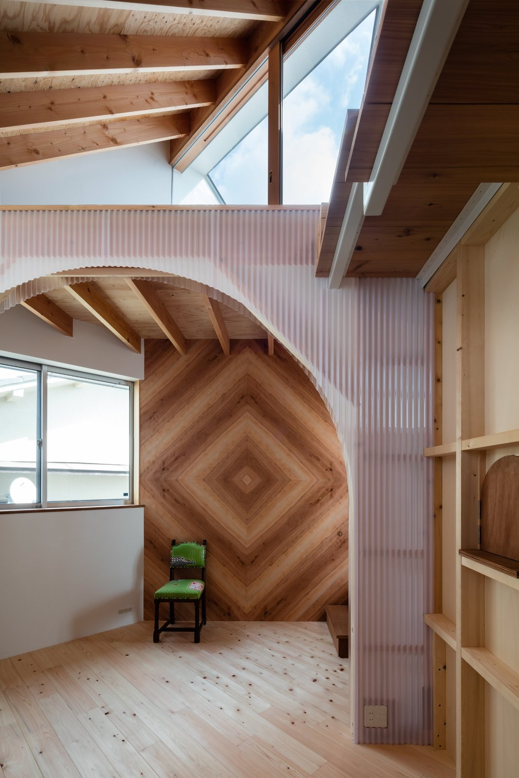 Hallway and Light Hardwood Floor Poly-carbonate sheets used to separate the functional zones, allow light to pass through, so all areas of the home well illuminated by natural light.  Photo 14 of 17 in This Whimsical Home in Japan Encourages Play and Exploration