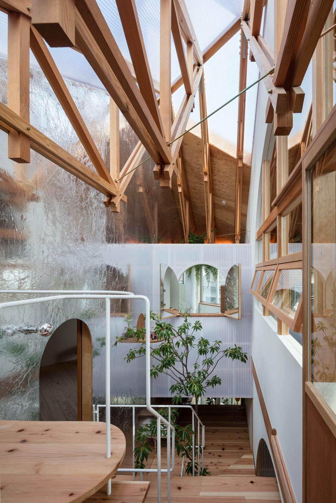 Staircase and Wood Tread A wooden truss structure supports the beam of the large roof and the exterior walls.  Photo 11 of 17 in This Whimsical Home in Japan Encourages Play and Exploration