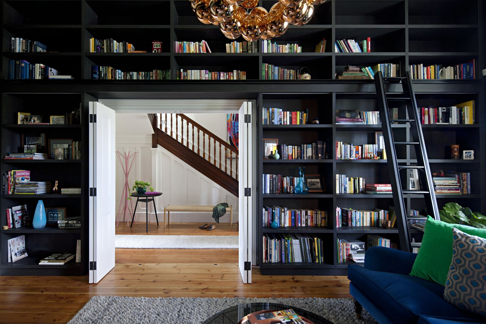Office, Medium Hardwood, Bookcase, Shelves, Library, and Rug The new layout maximizes the utility of the home's 4,100 square feet.  Office Medium Hardwood Library Photos from A Steel Mesh Curtain Wraps Around This Renovated Australian Home