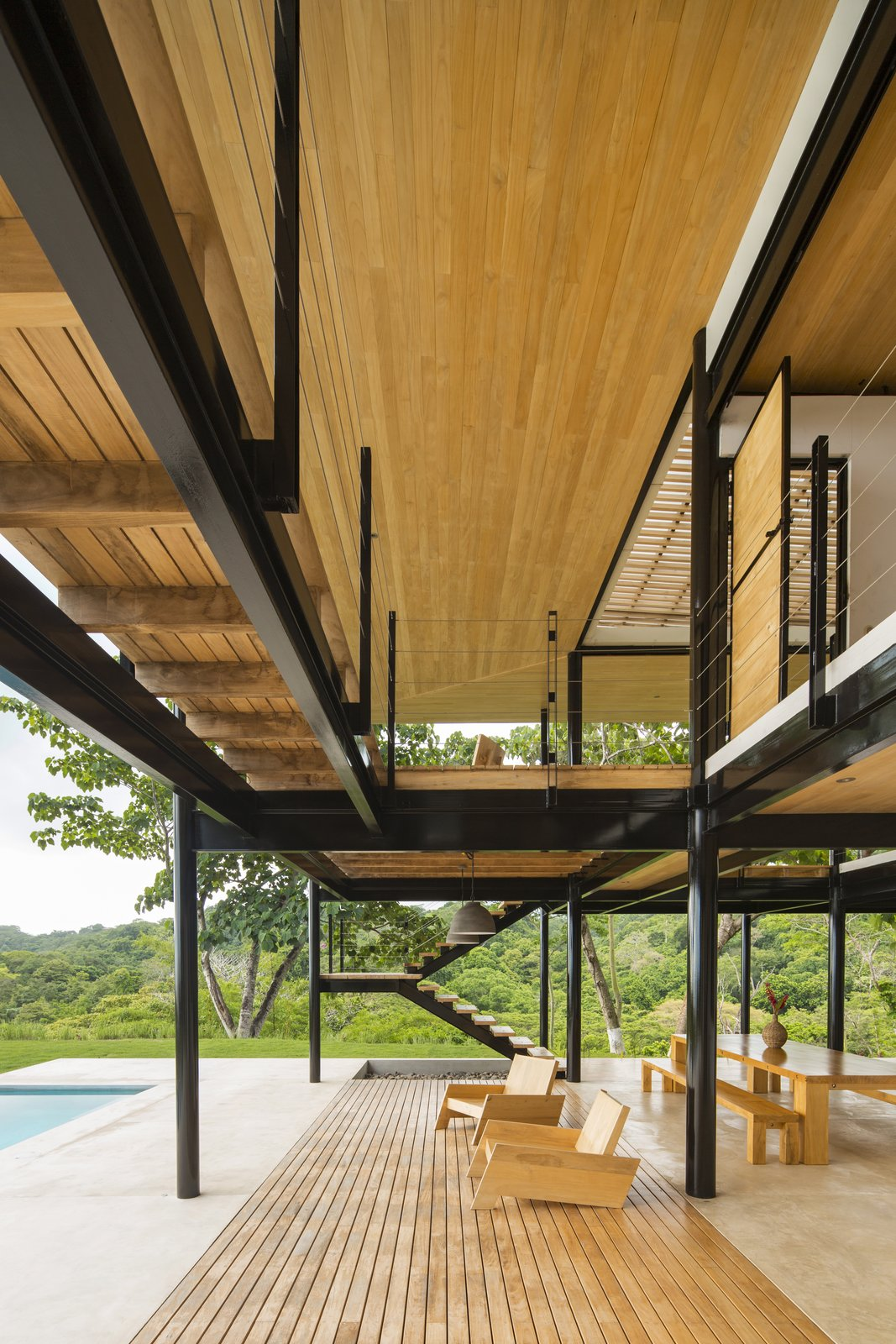 Outdoor, Front Yard, Lap, Large, Grass, Wood, and Trees The outdoor dining and lounge area flows out toward the pool.    Best Outdoor Lap Wood Photos from Moveable Walls Amplify Sublime Views For This Costa Rican Home
