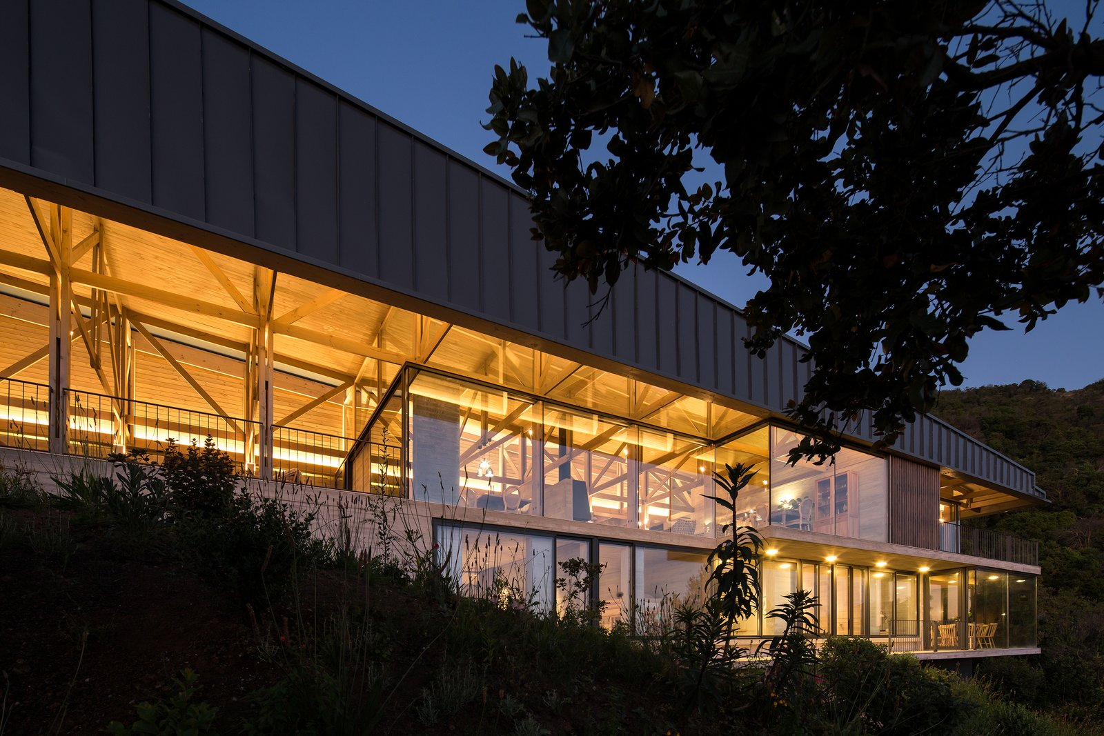 Exterior, Concrete Siding Material, Glass Siding Material, Flat RoofLine, House Building Type, and Green Roof Material Set on the lower section of the slope, the second volume has a more modern facade, featuring concrete, steel, and glass materials.    Photo 4 of 14 in Two Eclectic Volumes Unite This  Contemporary Chilean Home