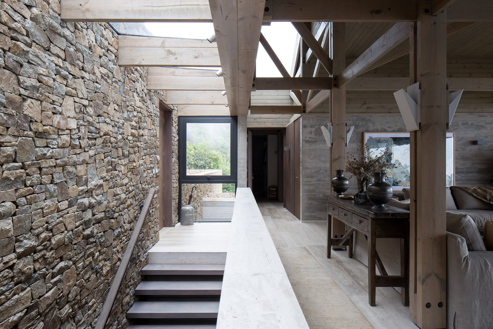 Staircase and Concrete Tread A material palette of concrete, wood, stone, and marble both contrast and complement the native sclerophyll trees around the site.    Photo 9 of 14 in Two Eclectic Volumes Unite This  Contemporary Chilean Home