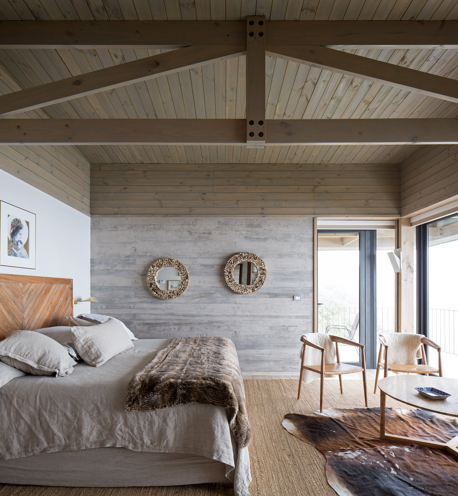 Bedroom, Rug, Bed, Chair, Light Hardwood, and Wall On the opposite end of the pool is an ensuite bedroom that is connected to a smaller, corner terrace.    Best Bedroom Wall Rug Light Hardwood Photos from Two Eclectic Volumes Unite This  Contemporary Chilean Home