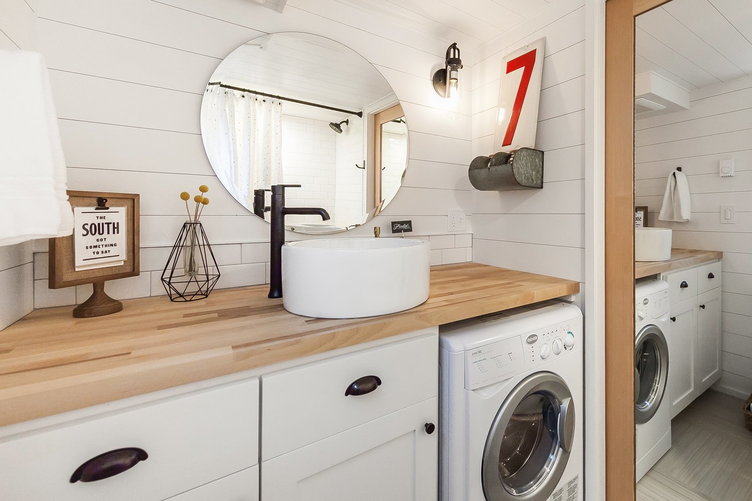 Laundry, Side-by-Side, White, and Wood A large oval mirror makes the bathroom look and feel larger.    Best Laundry Photos from A Family Customizes an Off-Grid Tiny Home With Online Design Tools