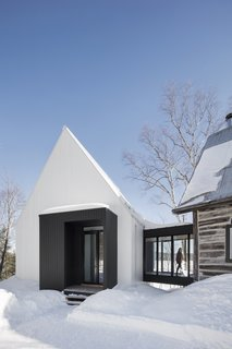 The ribbed texture of the facade echoes the whitewashed walls of the area's rural barns.