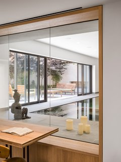 Elements such as the wood joists, wood columns, concrete floors, and machinery from the original building were salvaged and incorporated into the living spaces of the new residence.