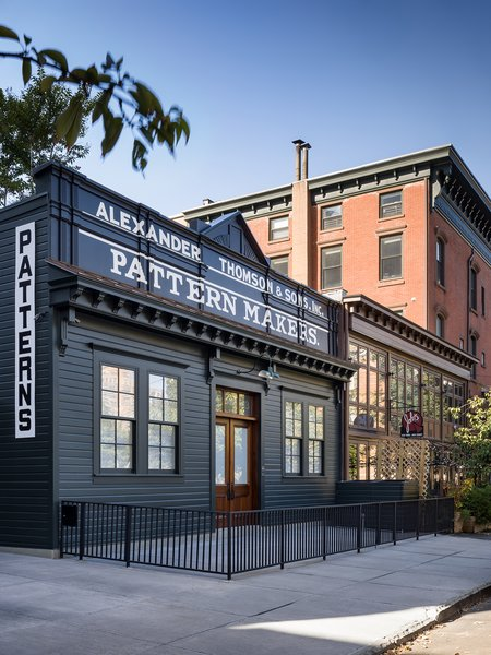 New York City–based architecture and interior design firm Fogarty Finger transformed this propeller factory into a stylish, modern home that gives a firm nod to its industrial past. The firm preserved the building's historic facade and the original company sign.
